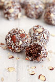 Chocolate Coconut balls. Chocolate coconut almond balls partially eaten Royalty Free Stock Images
