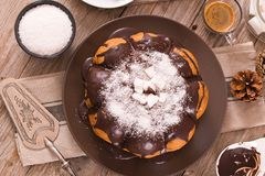 Chocolate coconut cake. Chocolate coconut cake with icing sugar royalty free stock image