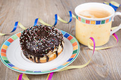 Chocolate and coconut donuts with carnival decoration. Royalty Free Stock Photos