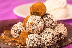 Chocolate with coconut flakes and cocoa powder, closeup. Stock Image