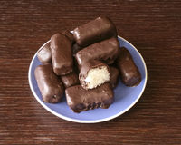 Chocolate coconut. Homemade chocolate coconut on blue plate stock photography