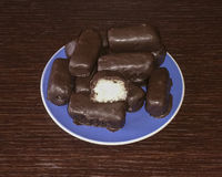 Chocolate coconut. Homemade chocolate coconut on blue plate royalty free stock photos