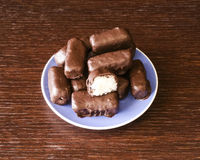 Chocolate coconut. Homemade chocolate coconut on blue plate stock photo