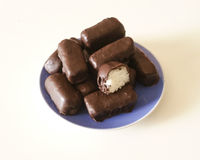 Chocolate coconut. Homemade chocolate coconut on blue plate royalty free stock images