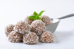 Chocolate coconut truffles. Chocolate truffles rolled in coconut flakes royalty free stock image