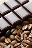 Chocolate and coffe beans Royalty Free Stock Photos