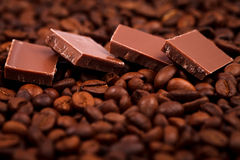 Chocolate and coffe beans Stock Images