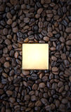 Chocolate and Coffee. Chocolate candy in the middle of fresh delicious coffee beans Royalty Free Stock Photography