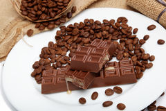 Chocolate and coffee beans. Chocolate and coffee beans on sacking Royalty Free Stock Photo