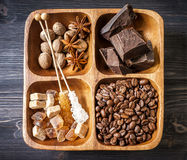 Chocolate, coffee beans, assorted spices and cane sugar Stock Photography