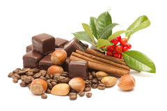 Chocolate, coffee beans, cinnamon and nuts Royalty Free Stock Images