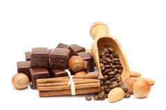 Chocolate, coffee beans, cinnamon and nuts Royalty Free Stock Photos