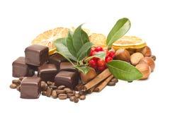 Chocolate, coffee beans, cinnamon, orange Royalty Free Stock Images