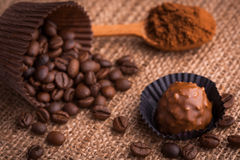 Chocolate, coffee beans and cocoa on the burlap Royalty Free Stock Photos