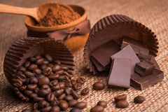 Chocolate, coffee beans and cocoa on the burlap Stock Image