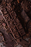 Chocolate, coffee beans. and cocoa powder. Chocolate bar pieces. dark chocolate background. A large bar of chocolate stock photography