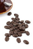 Chocolate coffee beans with cup and saucer on the background Stock Image