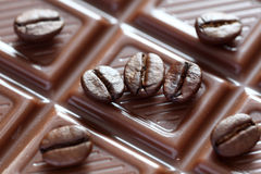 Chocolate and coffee beans. Milk chocolate and coffee beans close-up Royalty Free Stock Photos