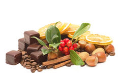 Chocolate, coffee beans, nuts, cinnamon sticks Stock Images