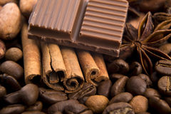 Chocolate with coffee beans, spices and cacao Royalty Free Stock Images