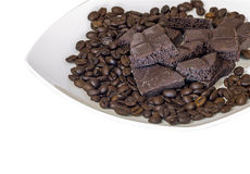 Chocolate and coffee beans on a white plate isolated background Stock Photography