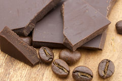 Chocolate and coffee beans. On wooden background Stock Photography