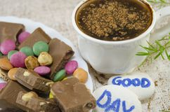 Chocolate coffee with bonbons and a Royalty Free Stock Photo