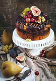 Chocolate coffee cake decorated with fresh fruits. Homemade Chocolate coffee cake decorated with fresh fruits Stock Photography
