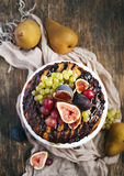 Chocolate coffee cake decorated with fresh fruits Royalty Free Stock Images