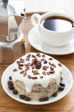 Chocolate coffee cake with icing, vertical Royalty Free Stock Photography