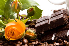 Chocolate, coffee, cinnamon and yellow flower Royalty Free Stock Photo