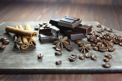 Chocolate, coffee grains, cinnamon and anisetree Royalty Free Stock Image