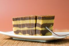 Chocolate or coffee layer cake. Served on white plate Royalty Free Stock Image