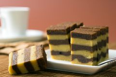 Chocolate or coffee layer cake. Served on white plate Stock Photography