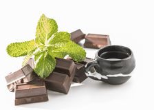 Chocolate,coffee and mint leaves Royalty Free Stock Images