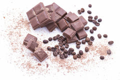Chocolate and coffee. Pieces of chocolate and coffee beans royalty free stock photography