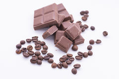 Chocolate and coffee. Pieces of chocolate and coffee beans royalty free stock images