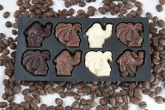 Chocolate and the coffee seeds Royalty Free Stock Photography