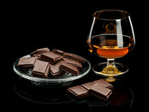 Chocolate and cognac in glassware it is  on black Stock Photo