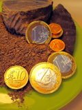 Chocolate and coin Royalty Free Stock Image