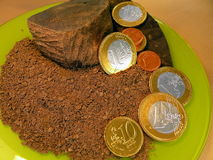 Chocolate and coin Stock Image
