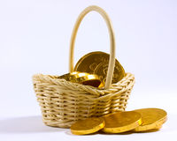 Chocolate coins in basket Royalty Free Stock Photo