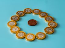 Chocolate coins on celestial background.  stock photos