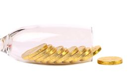 Chocolate coins get out of wineglass. Royalty Free Stock Photo