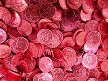 Chocolate Coins Wrapped in Red Foil royalty free stock photo