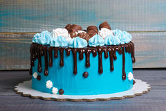 Chocolate color drip cream cheese cake with merengues Royalty Free Stock Images