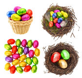 Chocolate and colored easter eggs in gold, red, green Stock Photos