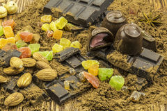 Chocolate, colorful candy, candied lime, lie on a wooden backgro. Eastern sweets, candy, chocolate, lie on a wooden background stock photos