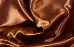 Chocolate colour satin background Royalty Free Stock Images