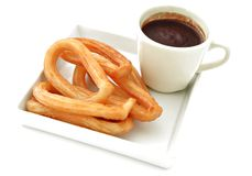 Chocolate con churros. Served in a cool plate Royalty Free Stock Photo
